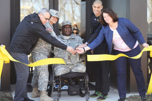 Col. Gregory D. Gadson, U.S. Army Garrison Fort Belvoir commander, with members of the installation's command team and Directorate of Family and Morale, Welfare and Recreation officials, cut the ribbon to officially open the new Kawamura Human Performance Center, Monday. Left to right: George Dickson, DFMWR business operations officer; Command Sgt. Maj. Carolyn Reynolds, U.S. Army Garrison Fort Belvoir Headquarters Battalion; Gadson; Joe Castro, Kawamura Human Performance Center certified strength and conditioning specialist; and Sheila Edwards, Fort Belvoir sports director.
