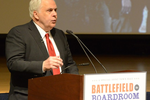 Fred Smith, CEO of FedEx, speaks about his wartime experiences and about FedEx during a town hall meeting at the Pentagon, Feb. 28, 2014. The event, called Battlefield to Boardroom, commemorates the 50th anniversary of the Vietnam War.