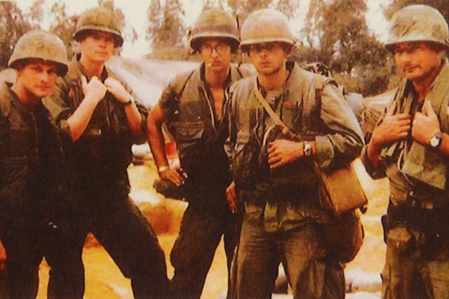 1st Lt. Fred Smith (second from right) poses with fellow Soldiers from Kilo Company in the Tam Ky area of South Vietnam in the fall of 1967. Two of the Marines pictures were later killed in action.