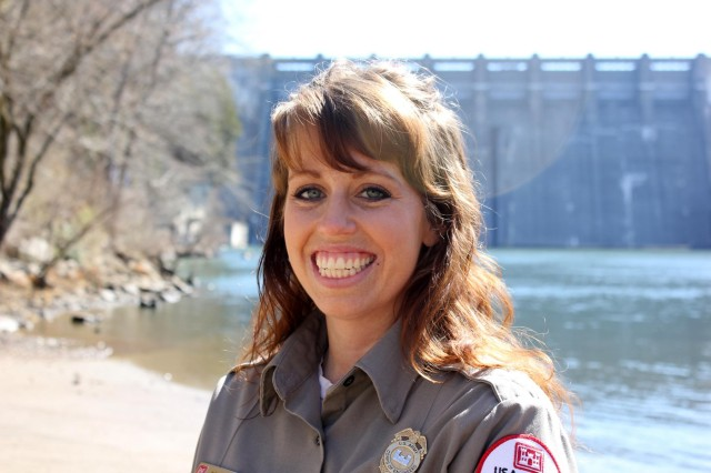 Sarah Peace, park ranger and natural resource specialist at the U.S. Army Corps of Engineers Nashville District's Center Hill Lake in Lancaster, Tenn., is the Nashville District Employee of the Month for January 2014. Here she is below Center Hill Dam in Lancaster, Tenn., Feb. 27, 2014.