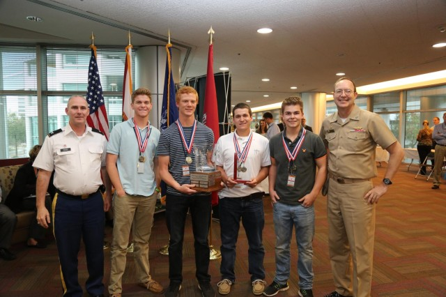 The winning team, Eagle's View Academy, Team A, was awarded the James L. Garland Award for Engineering Excellence. From left: Col. Alan M. Dodd, commander, Jacksonville District Corps of Engineers, Tucker Davis, Ryan Criswell, Ryan Stevens, Eric Rodich and Capt. Christopher H. Kiwus, president, Society of American Engineers Jacksonville Post.
