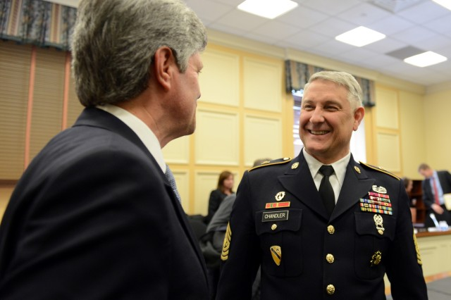 Sgt. Maj. of the Army Raymond F. Chandler III (right) meets with Rep. Jeff Fortenberry of Nebraska prior to his participation in a Congressional hearing in Washington, DC, to discuss the quality of life of U.S. service members and their families, Feb. 26, 2014.