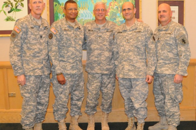 Army Reserve Maj. Gen. William M. Buckler, Jr., commander of 412th Theater Engineer Command, fourth from left, in a photo op with other key leaders from across the country at the US Army Pacific Commanders Conference held at Fort Shafter, Hawaii. Pictured from Left to Right: Command Sgt. Kurtis Timmer and Maj. Gen. Sanford Holman of 200th Military Police Command, Maj. Gen. James Boozer of U.S. Army Japan & I Corps Forward, and Maj. Gen. Buckler and Command Sgt. Maj. Ronald Flubacher of 412th TEC.