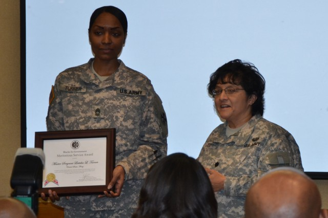 Master Sgt. Latisha Turner (left) was awarded the 2013 Blacks in Government Meritorious Service Award during the African American History Month Lunch on Yongsan Garrison in February.