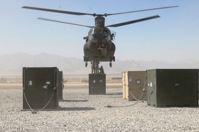 Soldiers with 703rd Brigade Support Battalion (BSB), 4th Infantry BCT, 3rd Infantry Division (4-1 ID), sling-load a container to a CH-47 Chinook helicopter, Oct. 15, 2013, on Forward Operating Base Shank, Afghanistan.