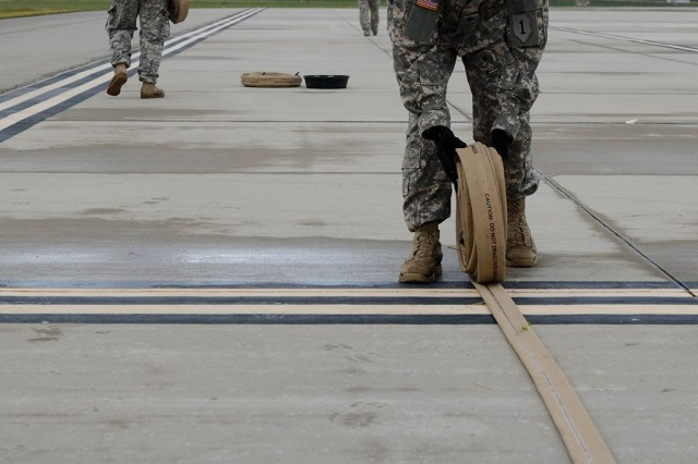 Spc. Gavin Wright, a petroleum supply specialist with 1st Battalion, 16th Infantry Regiment, 1st Armored Brigade Combat Team (BCT), 1st Infantry Division, unrolls a fuel hose during aviation fuel-operations training Sept. 11, 2013, at Marshall Army Airfield, Fort Riley, Kan.. LRCs manage bulk fuel supply in addition to many other instal­lation supplies and services.