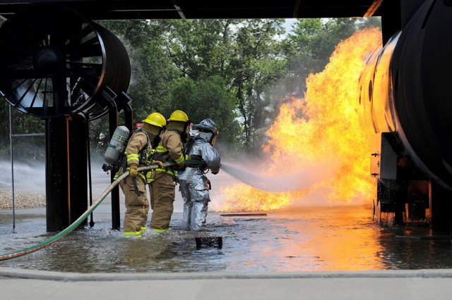 Members of the U.S. Army Reserve and Air National Guard (ANG) practice extinguishing a fire during Exercise Patriot 13 at Volk Field, Wis., July 17, 2013. The Patriot exercise is a domestic operations scenario to assess the ANG�'s ability to assist state and local agencies in response to multiple emergencies. The transition to LRCs postures AMC to support the vision of Defense Support to Civil Authorities, among other doctrine.