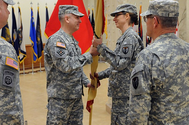 Col. Sue Henderson receives the ASC-ARE colors from Brig. Gen. Phillip Jolly, commander of Army Reserve Sustainment Command, during a change of command ceremony in Heritage Hall at Rock Island Arsenal, Ill., March 1. Henderson replaces Col. Vincent Barker. (Photo by Sgt. 1st Class Shannon Wright, ASC Public Affairs Office)