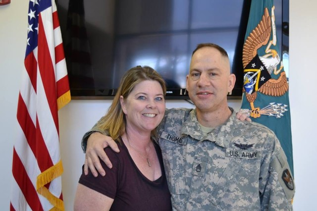 Staff Sgt. David L. Thomas, noncommissioned officer in charge, G-2, 1st Space Battalion, poses with his wife, Elizabeth McCrocklin Thomas, following his Army Space Badge ceremony in January. Thomas was diagnosed with Stage IV lung cancer that metastasized to the brain in April 2013.