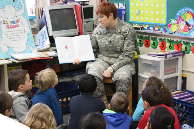 PICATINNY ARSENAL, N.J. - Lt. Col. Christine Allen, Product Manager, Counter Explosive Hazard, reads to children at the Dennis B. O' Brien Elementary School in Rockaway, March 4.