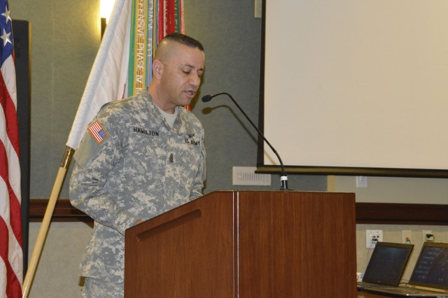 Former Command Sgt. Maj. Russell Hamilton speaks to the Soldiers of the 100th Missile Defense Brigade (Ground-based Midcourse Defense) during the Change of Responsibility at the 4th Infantry Division Headquarters auditorium on Fort Carson, Colo., Feb. 27. During the ceremony, Hamilton passed the sword to Command Sgt. Maj. Terry Alflen signifying the changing of responsibility between the two.