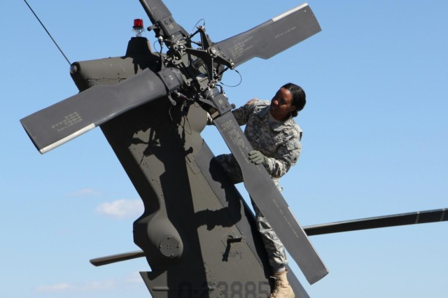 Army 1st. Lt. Demetria Elosiebo inspects a UH-60 Black Hawk tail rotor during a pre-flight check. Elosiebo, who recently graduated from flight school, is the first African-American female aviator in the District of Columbia Army National Guard.