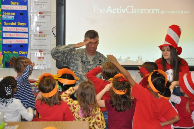 """Whatever you want to be: a soldier, astronaut, a doctor or a lawyer. You've got to read, because it is the gas that fuels dreams,"" said Lt. Col. Christopher Brown, chief of AMC's assistance and investigation branch, as he read to  energetic kindergarteners. The U.S. Army Materiel Command supported J.E. Williams Elementary for the annual Read Across America event, March 5."