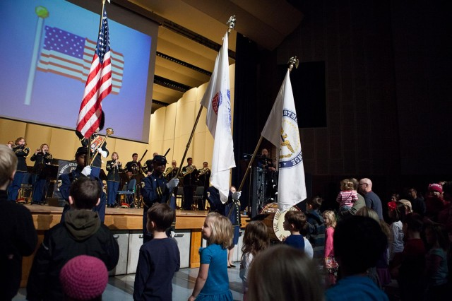 Members of The Junior Buffalo Soldiers Drill Team present the flags for the playing of the national anthem during The U.S. Army Band (Pershing's Own), Musical Stories for Kids of All Ages event at The U.S. Army Bandsh Brucker Hall on the Fort Myer portion of Joint Base Myer-Henderson Hall, March 1. The event included an informative, kid-friendly show and an instrument petting corral, where children had the opportunity to play instruments.