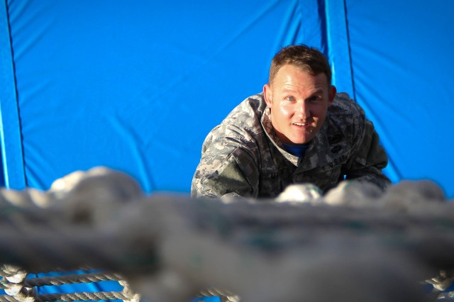 Chief Warrant Officer 3 Ryan Martin, an instructor at the Adjutant General School, climbs down the cargo net after successfully completing the 40-foot rappel at Fort Jackson's Victory Tower February 21.