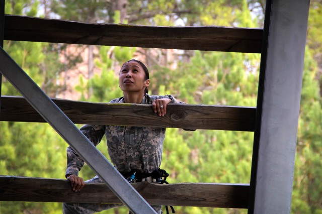 Second Lt. Paulette Prince, a student with the Adjutant General School, takes a moment to consider her next step as she negotiates the ladder to the top of the 40-foot rappel tower at Fort Jackson's Victory Tower training site Feb. 21.