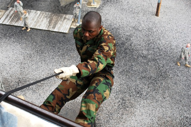 Liberian Army Capt. Robert Jadoe, a student with the Adjutant General School, successfully completes the 40-foot rappel at Fort Jackson's Victory Tower training site Feb. 21.
