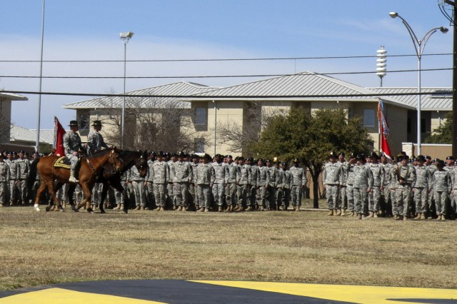 Maj. Gen. Anthony Ierardi (far right horse), outgoing commander, 1st Cavalry Division, and Brig. Gen. Michael Bills, commanding general, 1st Cavalry Division, inspect the brigade's within the division during a change of command ceremony on Cooper Field at Fort Hood, Texas, March 4. Bills joins the First Team following his tenure as the acting senior commander of 4th Infantry Division and Fort Carson. (U.S. Army photo by Sgt. Angel Turner, 1st Cav. Div. Public Affairs (Released))