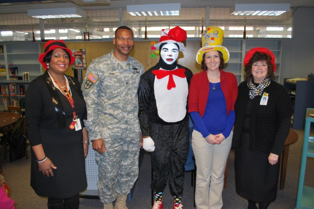 Col. Jerry Jones, Expeditionary Contracting Command chief of staff poses with Stephanie Varner(left), the Cat in the Hat, Shannon Pilotte, and Morris elementary School Principal Patty Boyd. Jones was one of 10 Army Contracting Command volunteers during Read Across America Day.