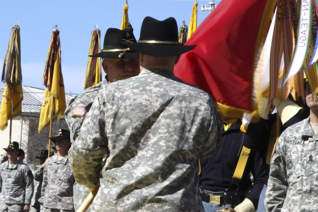Lt. Gen. Mark A. Milley (center), commander, III Corps and Fort Hood, passes the 1st Cavalry Division Colors to incoming division commander, Brig. Gen. Michael Bills, during the 1st Cavalry Division change of command ceremony on Cooper Field at Fort Hood, Texas March 4. Bills took command from outgoing commander Maj. Gen. Anthony Ierardi, who will become the deputy commanding general of III Corps. (U.S. Army photo by Sgt. Angel Turner, 1st Cav. Div. Public Affairs (Released)