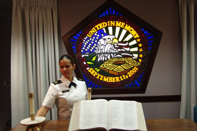 Pentagon chaplain assistant Staff Sgt. Denises Veitia prepares the chapel for service.
