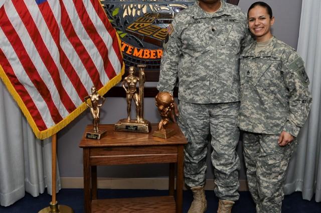 Pentagon Chapel Unit Ministry Team, Chaplain (Lt. Col.) C. Wayne Brittian and Staff Sgt. Denises Veitia with Veitia's bodybuilding trophies.