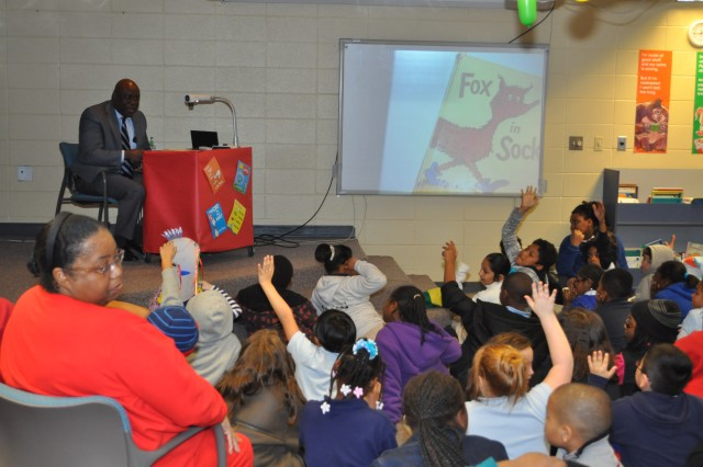 """Keith Jackson, Army Contracting Command chief of staff, gets a reaction from Morris Elementary School third graders after he asked how many had a library at home. Jackson read Dr. Seuss' """"Fox in Socks"""" to the students March 3 as part of the National Read Across America Day."""