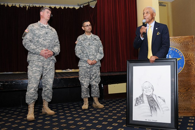 Col. Shawn Prickett, 1st Aviation Brigade commander, and Sgt. 1st Class Jason Garcia, 1st Aviation Brigade equal opportunity officer, present a portrait of Rosa Parks to Edward Vaughn, retired Michigan state representative and lifelong member of the NAACP, at the 2014 African-American Black History Month Luncheon at The Landing Feb. 27.
