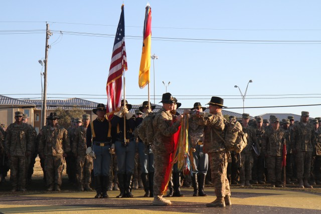 Lt. Col. Phil Brooks (left), commander of 3rd Battalion, 82nd Field Artillery Regiment, 2nd Brigade Combat Team, 1st Cavalry Division, and Command Sgt. Maj. Theodore Durand, battalion command sergeant major uncase the unit colors during their welcome home ceremony at Cooper Field on Fort Hood, Texas, March 1.  The unit was deployed on a security assistance mission in Afghanistan, and was greeted by cheering Family and friends following a nine-month deployment. (U.S. Army photo by Sgt. Angel Turner, 1st Cav. Div. PAO (Released)