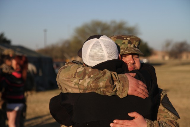 "Sgt. Dustin Valdez embraces his dad Oscar during a welcome home ceremony on Cooper Field at Fort Hood, Texas, March 1. �""It�'s overwhelming to be home,"" said Valdez, a mechanic assigned to Battery A, 3rd Battalion, 82nd Field Artillery Regiment, 2nd Brigade Combat Team, 1st Cavalry Division. Valdez was deployed with 3-82 FAR on a security assistance mission in Afghanistan and returned home following a nine-month deployment. (U.S. Army photo by Sgt. Angel Turner, 1st Cav. Div. PAO (Released)"