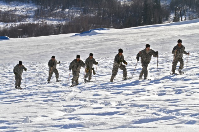 Members of the Japanese Ground Self Defense Force and instructors from U.S. Army Alaska's Northern Warfare Training Center snowshoe up Birch Hill on Fort Wainwright, Alaska during the JGSDF's visit March 3. (U.S. Army photo by Sgt. Michael Blalack, 1/25 SBCT Public Affairs)