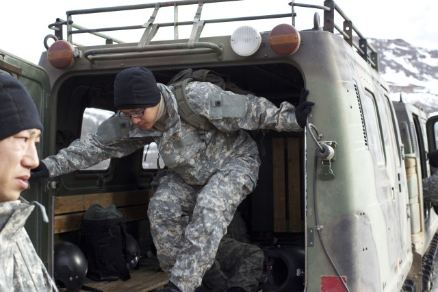 1st Lt. Norimitsu Sakai of the Japanese Ground Self Defense Force exits a Small Unit Support Vehicle at the Northern Warfare Training Center in Black Rapids, Alaska Feb. 27. (U.S. Army photo by Sgt. Michael Blalack, 1/25 SBCT Public Affairs)