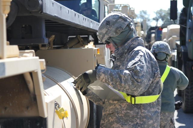 Sgt. Joseph G. Anthony, a transportation management coordinator with the 632nd Movement Control Team, 129th Combat Sustainment Support Battalion, 101st Sustainment Brigade, 101st Airborne Division (Air Assault), marks vehicles during a training exercise that validates the readiness of units to rapidly deploy Feb. 26, at Fort Campbell. The readiness exercise provides valuable feedback to determine how well prepared a unit is for rapid movement. (U.S. Army photo by Sgt. Leejay Lockhart, 101st Sustainment Brigade Public Affairs)