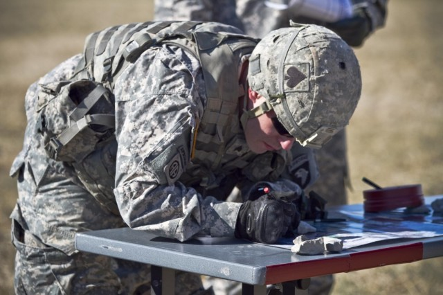 U.S. Army Sgt. Thomas M. Reedy, an infantryman with 1st Squadron, 61st Cavalry Regiment, 4th Brigade Combat Team, 101st Airborne Division (Air Assault), marks a map, Feb. 26, 2014, during the map reading and land navigation portion of the Noncommissioned Officer of the Quarter Competition. The next day, following the completion of the competition, Reedy was announced as the Soldier of the Quarter. (U.S. Army photo by Sgt. Justin A. Moeller, 4th Brigade Combat Team Public Affairs)