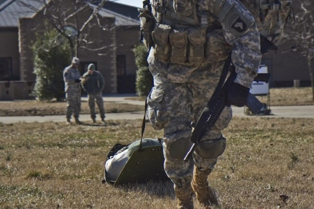 U.S. Army Sgt. Thomas M. Reedy, an infantryman with 1st Squadron, 61st Cavalry Regiment, 4th Brigade Combat Team, 101st Airborne Division (Air Assault), drags a simulated casualty to safety, Feb. 26, 2014, during the evaluate, treat and evacuate a casualty portion of the Noncommissioned Officer of the Quarter Competition. The next day, following the completion of the competition, Reedy was announced as the Soldier of the Quarter. (U.S. Army photo by Sgt. Justin A. Moeller, 4th Brigade Combat Team Public Affairs)