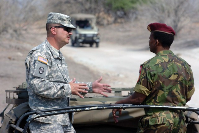 Command Sgt. Maj. John Swart, senior enlisted leader with the North Carolina National Guard, talks with a Botswana Defence Force soldier in a recent visit Swart made during a State Partnership Program engagement in the southern Africa country. North Carolina almost doubled its SPP engagements in 2013. As mobilizations overseas trend downward, the North Carolina Guard has used their State Partnership Program relationships as one tool to sustain readiness and training proficiency.