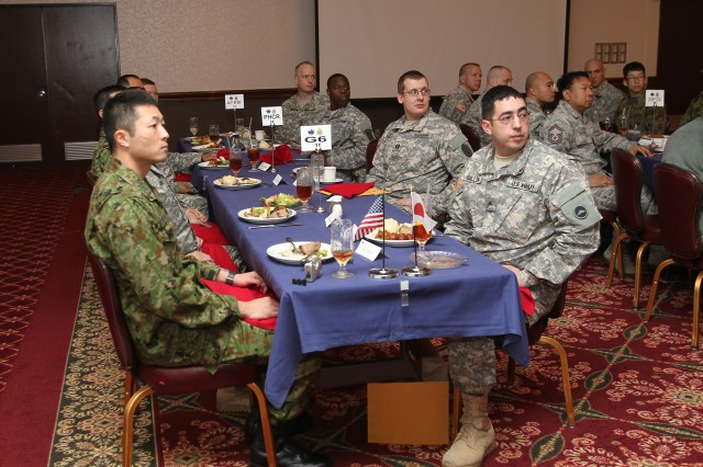 Several Cooperative Work Group class 71 members and their U.S. Army and Air Force sponsors listen to a speech by the senior class member during a reception in the graduates' honor Mar. 5 at Camp Zama, Japan.