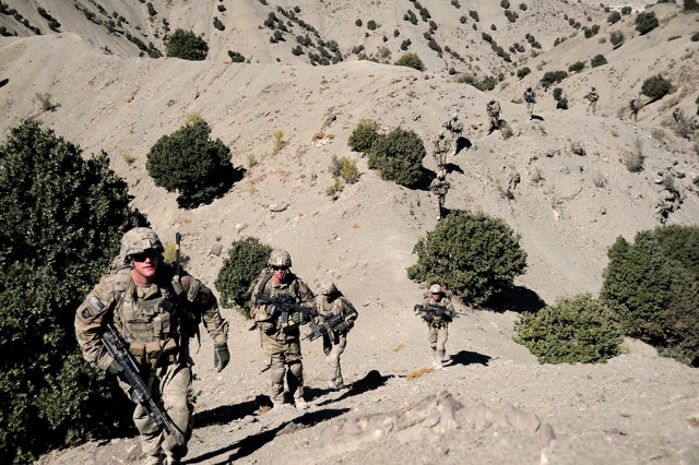 """Sgt. Zzachary McDonell, an infantryman with 1st Battalion, 506th Infantry Regiment """"Red Currahee,"""" 4th Brigade Combat Team (BCT), 101st Airborne Division (Air Assault), climbs a mountain trail with fellow Currahees on a joint patrol with Afghan National Army soldiers in Paktia province, Afghanistan, Oct. 21, 2013. High altitudes are one of the conditions for which MORE is designed, specifically with high carbohydrate content to combat acute mountain sickness."""