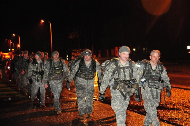 "Soldiers with 4-2 Stryker Brigade Combat Team, 7th Infantry Division complete a 25-mile ruck march known as the ""Manchu Mile"" March 6 on Joint Base Lewis-McChord, Wash. (U.S. Army photo by Sgt. Kimberly Hackbarth, 4-2 SBCT, 7th ID Public Affairs Office)"