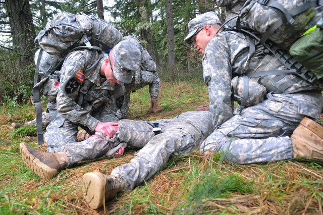 Soldiers with 2nd Squadron, 1st Cavalry Regiment, 4-2 Stryker Brigade Combat Team, 7th Infantry Division, assess and treat a mock casualty March 5 during a Spur Ride on Joint Base Lewis-McChord, Wash. (U.S. Army photo by Sgt. Kimberly Hackbarth, 4-2 SBCT, 7th ID Public Affairs Office)