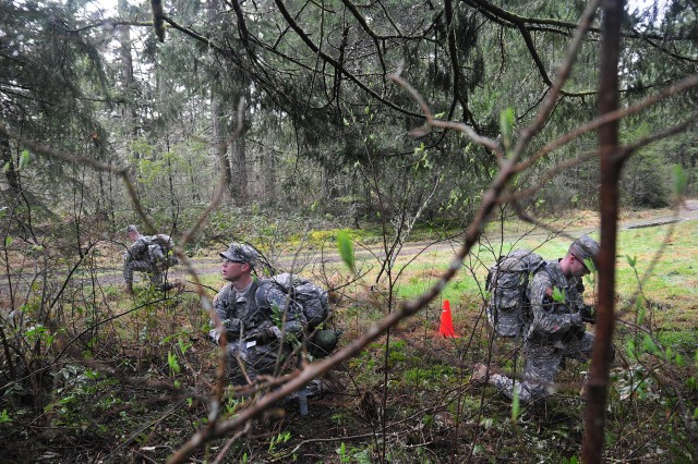 Soldiers with 2nd Squadron, 1st Cavalry Regiment, 4-2 Stryker Brigade Combat Team, 7th Infantry Division, prepare a medical evacuation request March 5 during a Spur Ride on Joint Base Lewis-McChord, Wash. (U.S. Army photo by Sgt. Kimberly Hackbarth, 4-2 SBCT, 7th ID Public Affairs Office)