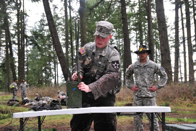 A soldier with 2nd Squadron, 1st Cavalry Regiment, 4-2 Stryker Brigade Combat Team, 7th Infantry Division, assembles an Advanced System Improvement (ASIP) Radio March 5 during a Spur Ride on Joint Base Lewis-McChord, Wash. (U.S. Army photo by Sgt. Kimberly Hackbarth, 4-2 SBCT, 7th ID Public Affairs Office)
