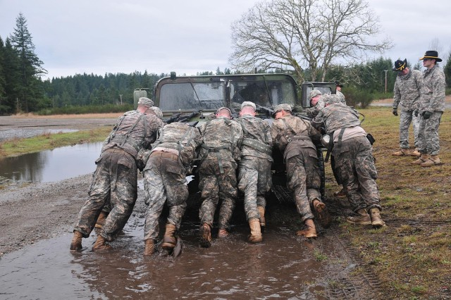 Soldiers with 2nd Squadron, 1st Cavalry Regiment, 4-2 Stryker Brigade Combat Team, 7th Infantry Division, push a Humvee March 5 during a Spur Ride on Joint Base Lewis-McChord, Wash. (U.S. Army photo by Sgt. Kimberly Hackbarth, 4-2 SBCT, 7th ID Public Affairs Office)