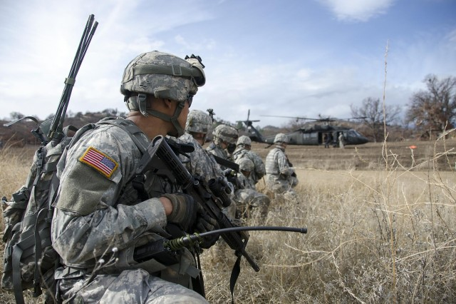 Soldiers of the California National Guard's 40th Infantry Division rehearsing an air assault mission at Fort Hunter Liggett Feb. 8. The soldiers are loading up a Black Hawk as part of a mission they've been tasked during annual training 2014.