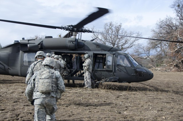 Soldiers of the California National Guard's 40th Infantry Division load up a UH-60 Black Hawk at Fort Hunter Liggett Feb. 8 as part of an air assault training mission.