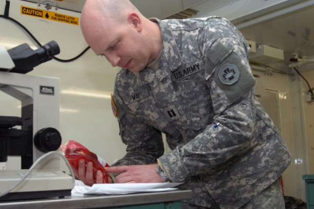 Capt. Shawn May, a native of Horseheads, NY, NY, checks on the status of avialable blood during the Global Medic exercise which is a portion of the Army Reserves Combat Support Training Exercise led by the 78th Training Division at Joint Base McGuire Dix Lakehurst.  During Global Medic,  the 865th Combat Support Hospital, headquartered in Utica, N.T.  personnel were joined by all branches of service in addition to Canadian military medical professionals. The hospital, similar to a trauma center used by civilians, was operated in a tactical environment simulating treatment for U.S. military personnel, as well as local nationals.