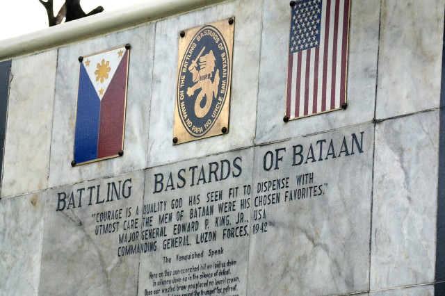 "The names and units of those U.S. military personal who died at, or in route to the Capas Concentration Camp during the Bataan Death March, are etched on marble?""and titled ?""Battling Bastards of Bataan.""  The memorial is located at the Capas National Shrine, in Capas, Tarlac, Philippines."