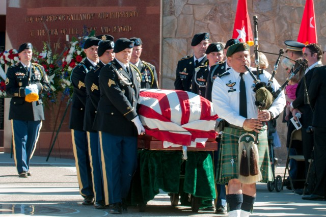 A bagpiper from the Los Angeles Police Department leads a procession of Soldiers with 1st Battalion, 18th Infantry Regiment, 2nd Armored Brigade Combat Team, 1st Infantry Division, as they transport the casket of Walter D. Ehlers during a March 8, 2014, memorial service at the Riverside National Cemetery in Riverside, Calif.