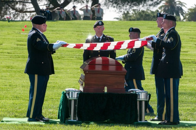 Soldiers with 1st Battalion, 18th Infantry Regiment, 2nd Armored Brigade Combat Team, 1st Infantry Division, fold an American flag over the casket of Walter D. Ehlers at a March 8, 2014, memorial service at the Riverside National Cemetery in Riverside, Calif.