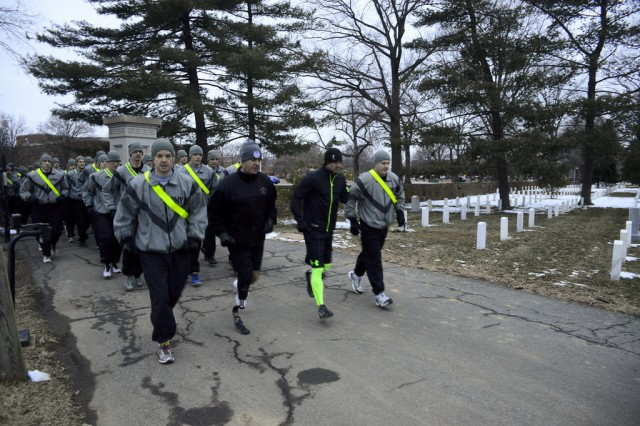 U.S. Army Military District of Washington Soldiers host a 3.5 mile run with retired Sgt. Noah Galloway, wounded warrior, in Arlington National Cemetery, Va., March 7, 2014.